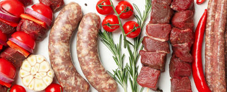Set of different raw barbecue meat on white background, top view Banco de Imagens