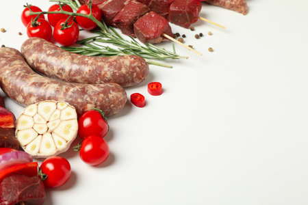 Set of different raw barbecue meat on white background, space for text Banco de Imagens