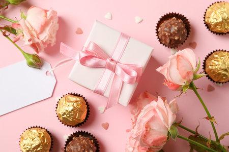 情人节的概念与玫瑰,糖果和礼物盒的在桃红色背景