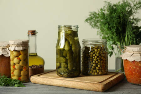 Different pickled food on gray wooden table