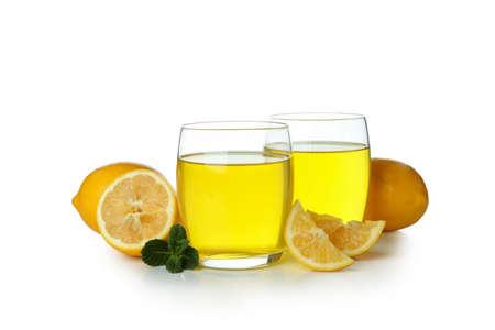 Glasses of lemon jelly, lemon slices and mint isolated on white background