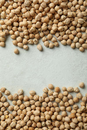 Fresh chickpea on white textured background, space for text