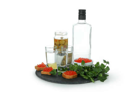 Tray with vodka and tasty snacks isolated on white background