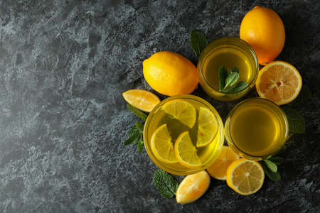 Concept of dessert with lemon jelly with lemon slices on black smokey table