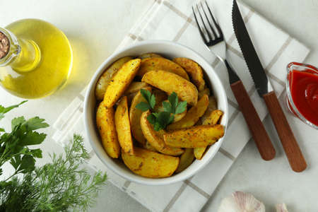 Concept of tasty meal with potato wedges, top view
