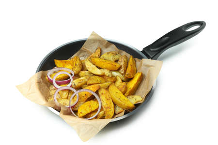 Pan with fried potato wedges isolated on white background 免版税图像