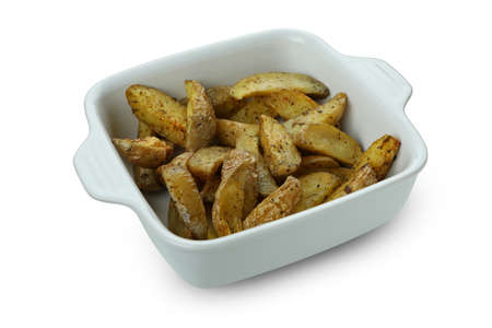 Bowl with potato wedges isolated on white background 免版税图像