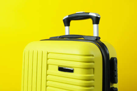 Travel bag on yellow background, close up 免版税图像