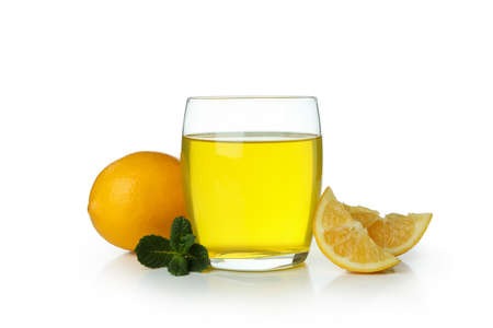 Glass of lemon jelly, lemon slices and mint isolated on white background