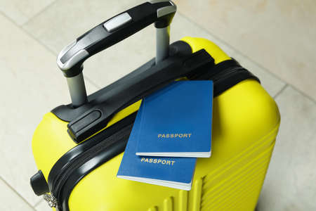 Yellow travel bag with passports, close up