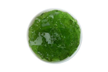 Bowl of kiwi jelly isolated on white background 免版税图像