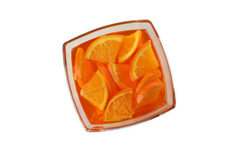 Bowl of orange jelly isolated on white background 免版税图像