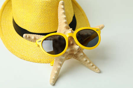 Hat, seastar, and sunglasses on white background Stock Photo