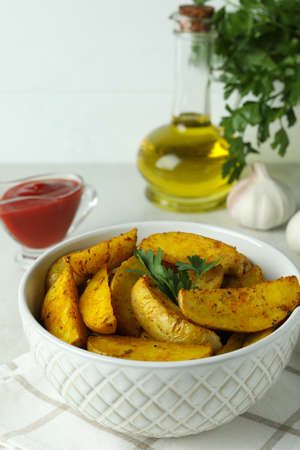 Concept of tasty meal with potato wedges, close up Standard-Bild