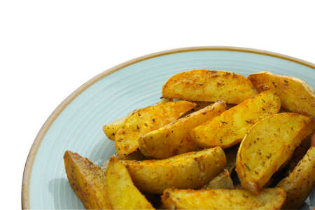 Plate with potato wedges isolated on white background