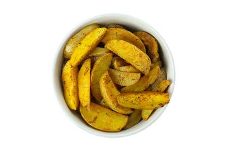 Bowl with baked potato wedges isolated on white background