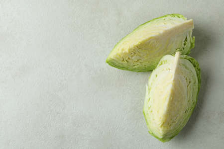 Fresh green cabbage on white textured table