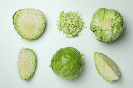 Flat lay with fresh cabbage on white background