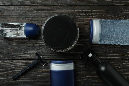 Concept of men's hygiene on wooden background