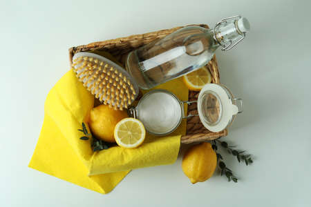 Cleaning concept with eco friendly cleaning tools and lemons on white background 스톡 콘텐츠