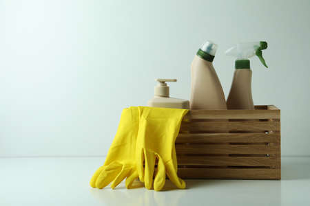 Wooden box with eco friendly cleaning tools on white table 스톡 콘텐츠