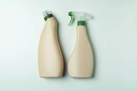 Blank detergent bottles on white background, space for text