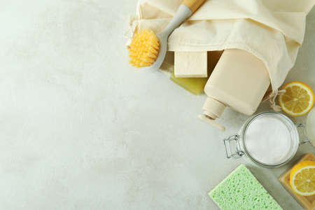 Cleaning concept with eco friendly cleaning tools on white textured table 스톡 콘텐츠
