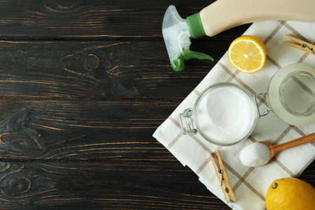 Eco friendly cleaning tools on wooden background
