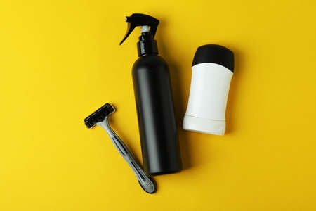 Concept of men's hygiene tools on yellow background 스톡 콘텐츠