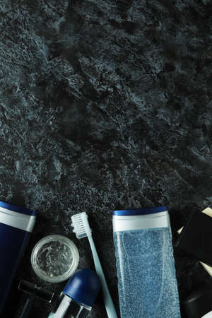 Concept of men's hygiene tools on black smokey table