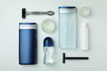 Concept of men's hygiene tools on white background