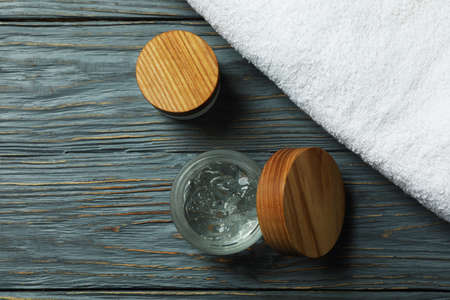 Styling gel and towel on wooden table