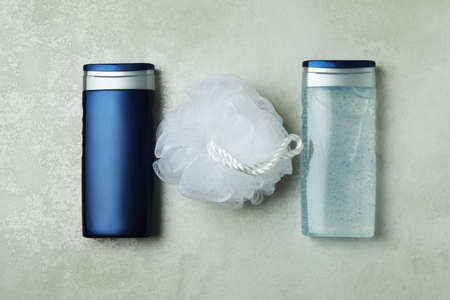 Concept of men's hygiene tools on textured background