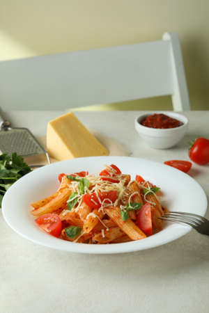 Concept of tasty food with pasta with tomato sauce and ingredients