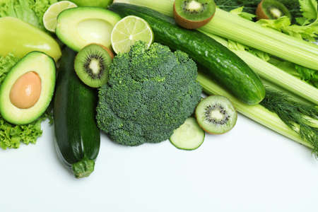 Fresh green vegetables on white background, space for text