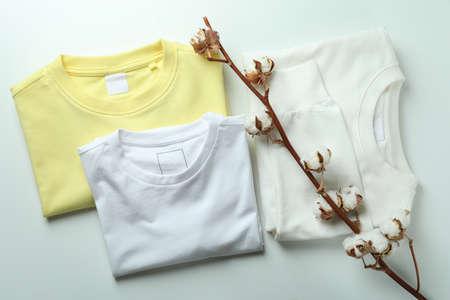 Sweatshirts, t - shirt and cotton on white background Foto de archivo