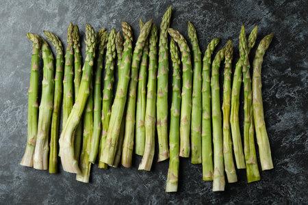 Fresh green asparagus on black smokey background