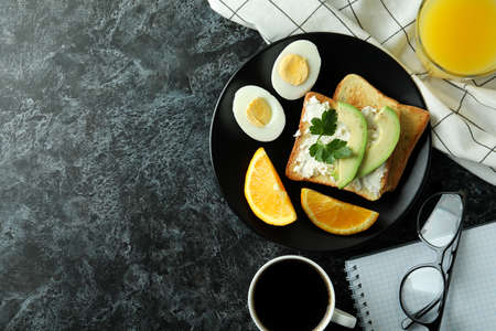 Concept of tasty breakfast with boiled eggs, space for text
