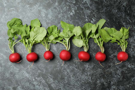 Fresh radish on black smokey background, space for text Banque d'images