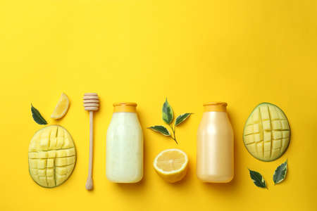 Natural mango shower gel and ingredients on yellow background