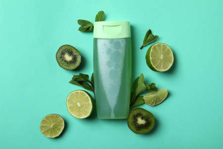 Shower gel and ingredients on mint background
