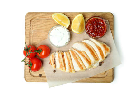 Board with grilled chicken meat isolated on white background Reklamní fotografie