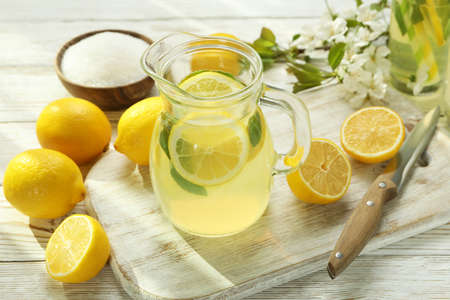 Concept of fresh summer drink with lemonade on white wooden table