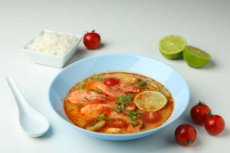 Tom yum soup and ingredients on white background