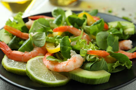 Shrimp salad with different ingredients, close up