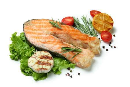 Tasty grilled salmon and ingredients on white background