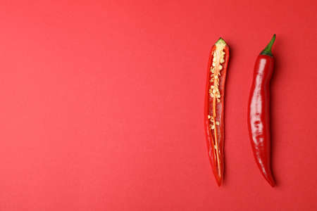 Red hot chili pepper on red background
