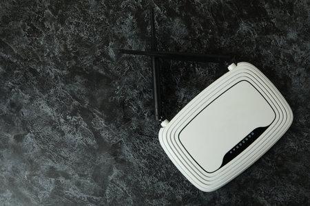 Wi Fi router with external antennas on black smokey background