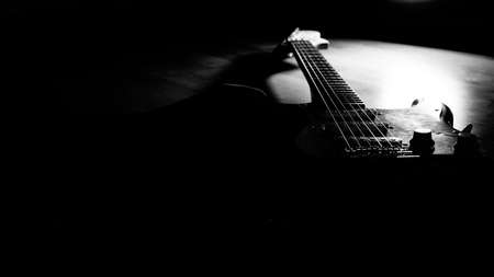 Black and white electric guitar in the shadow and light Stock fotó