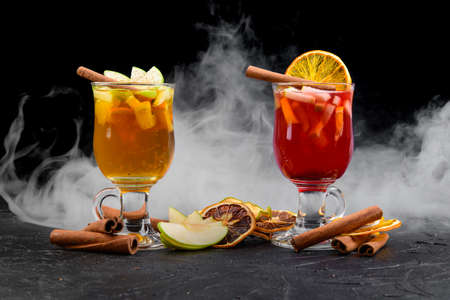 cocktails on a black background with smoke Stock Photo